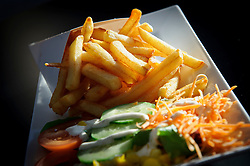 Belgian Fries - Chez Vincent - Bruges, Belgium. The twice-fried, thick-cut fries are practically unrecognizable from America's favorite fast-food side, especially when topped with a generous dollop of mayonnaise or curry sauce. (Photo © Jock Fistick)