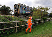 LITTLE CORNARD SUFFOLK.  Maintenance workers prepare to lift the two carriages and truck involved in yesterday's level crossing train crash in Little Cornard in Suffolk 18 August 2010. STEPHEN SIMPSON..