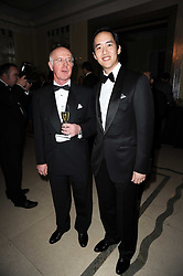 Left to right, JOHN OXX trainer of Sea The Stars and CHRISTOPHER TSUI owner of Sea The Stars at the Cartier Racing Awards 2009 held at Claridge's, Brook Street, London on 17th November 2009.
