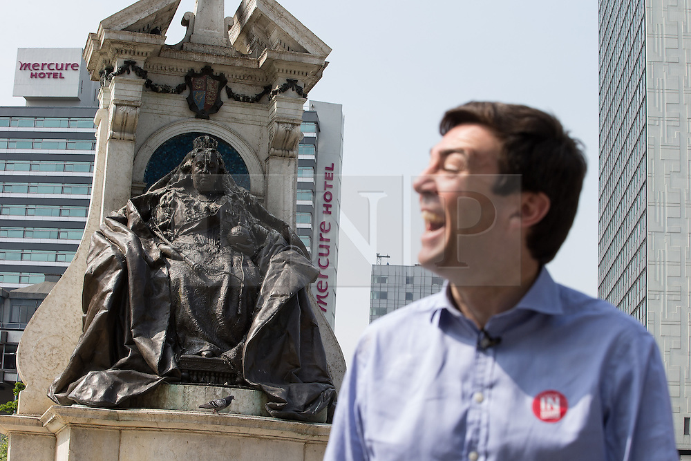 © Licensed to London News Pictures . 09/06/2016 . Manchester , UK . ANDY BURNHAM MP for Leigh and candidate for Labour's campaign for Greater Manchester Mayor , campaigning for Britain to Remain in the EU in Piccadilly Gardens in Manchester City Centre , in front of a statue of Queen Victoria . Photo credit : Joel Goodman/LNP