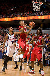 Maryland guard/forward Cliff Tucker (24) beats Virginia forward Adrian Joseph (30) to the basket.  The Virginia Cavaliers defeated the Maryland Terrapins 91-76 at the University of Virginia's John Paul Jones Arena  in Charlottesville, VA on March 9, 2008.