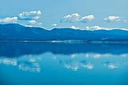 Coudes reflected in Kluane Lake. Ruby Range Mountain<br />Kluane National Park<br />Yukon<br />Canada