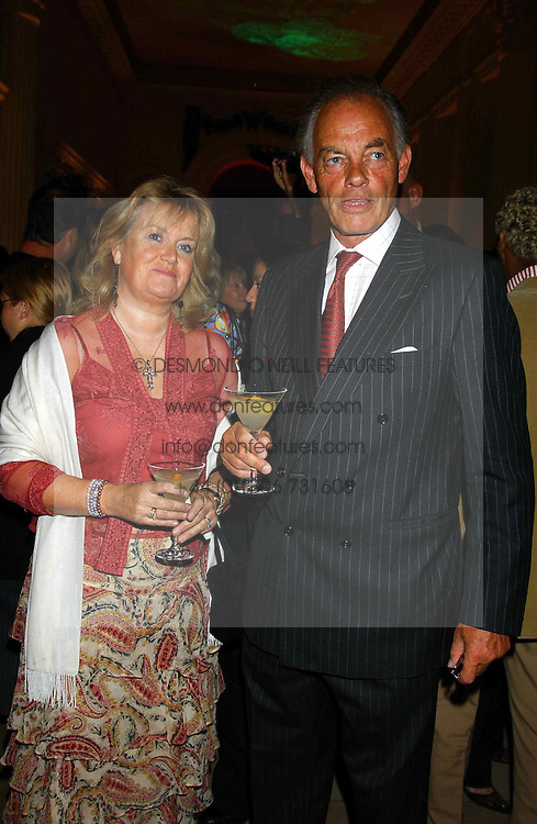 The MARQUESS & MARCHIONESS OF READING at a evening to celebrate the unveiling of the British Luxury Club at The Orangery, Kensington Palace, London W8 on 16th September 2004.<br />