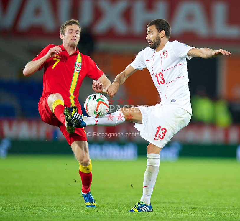 CARDIFF, WALES - Tuesday, September 10, 2013: Wales' Andy King in action against Serbia's Nikola Maksimovic during the 2014 FIFA World Cup Brazil Qualifying Group A match at the Cardiff CIty Stadium. (Pic by David Rawcliffe/Propaganda)