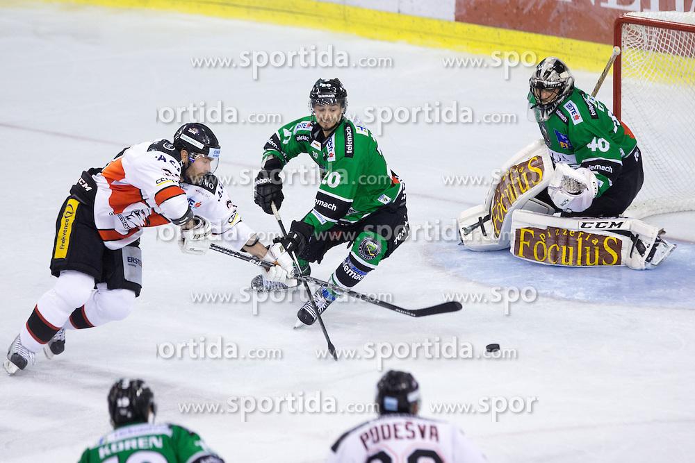 19.09.2014, Hala Tivoli, Ljubljana, SLO, EBEL, HDD Telemach Olimpija Ljubljana vs HC Znojmo Orli, 3. Runde, in picture Peter Pucher (HC Znojmo Orli, #33) vs Gregor Koblar (HDD Telemach Olimpija, #20) and Andy Chiodo (HDD Telemach Olimpija, #40) during the Erste Bank Icehockey League 3. Round between HDD Telemach Olimpija Ljubljana and HC Znojmo Orli at the Hala Tivoli, Ljubljana, Slovenia on 2014/09/19. Photo by Matic Klansek Velej / Sportida