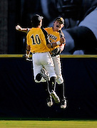 Alameda's Wes Moyer, right, celebrates with Jeff Perri after making the last out in a championship victory over Bishop O'Dowd.  The Hornets won their first ever 3-A East Bay title with the 6-3 win over the Dragons.