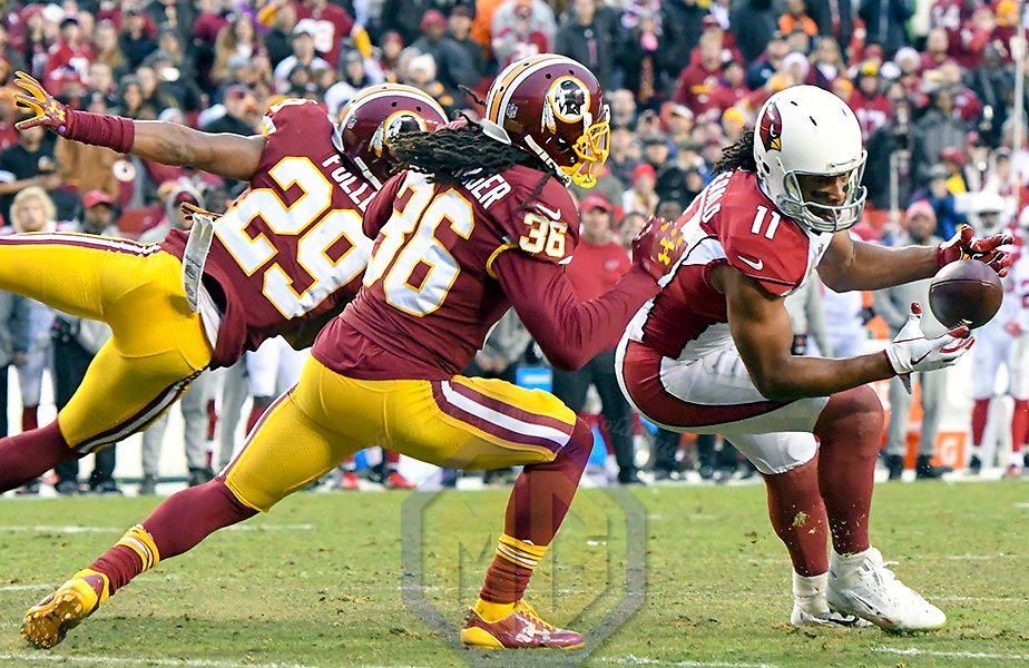 LANDOVER, MD - DECEMBER 17: Arizona Cardinals wide receiver Larry Fitzgerald (11) cannot hang on to a fourth quarter pass on a fourth down play against the defense of Washington Redskins cornerback Kendall Fuller (29) and free safety D.J. Swearinger (36) on December 17, 2017, at FedEx Field in Landover, MD. The Washington Redskins defeated the Arizona Cardinals, 20-15.  (Photo by Mark Goldman/Icon Sportswire)