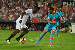 August 20, 2018 - Valencia, U.S. - VALENCIA, SPAIN  - AUGUST 20:  Michy  batshuayi forward of Valencia cf dribble to Diego Godin of Atletico de Madrid during the La Liga between Valencia CF and Atletico de Madrid on August 20, 2018 at Mestalla in Valencia, Spain. (Photo by Carlos Sanchez Martinez/Icon Sportswire) (Credit Image: © Carlos Sanchez Martinez/Icon SMI via ZUMA Press)
