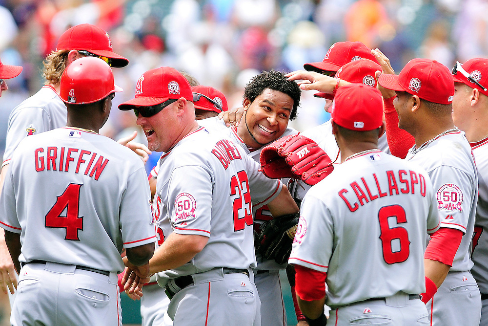 CLEVELAND, OH - JULY 27: Starting pitcher Ervin Santana #54 of the Los Angeles Angels celebrates with his teammates after throwing a no-hitter against the Cleveland Indians at Progressive Field on July 27, 2011 in Cleveland, Ohio. The Angels defeated the Indians 3-1. (Photo by Jason Miller/Getty Images)  *** Local Caption *** Ervin Santana