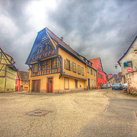 Traditional-looking half-timbered homes in the small quiet Alsatian village of St. Hippolyte, along the Alsatian wine road. Owing to it's shared culture with Germany, the homes in the Alsace take on this popular medieval German look of the exposed timber beams, starting on the second floor. (HDR version)