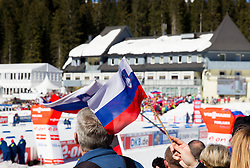 Slovenian flags during Women 12.5 km Mass Start competition of the e.on IBU Biathlon World Cup on Sunday, March 9, 2014 in Pokljuka, Slovenia. Photo by Vid Ponikvar / Sportida