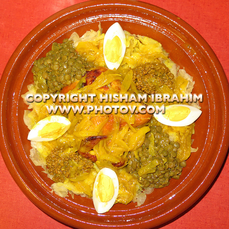 Rfissa - Chicken Rfissa - Shredded pastry with chicken, saffron, lentil and boiled eggs - Traditional Moroccan Dish.
