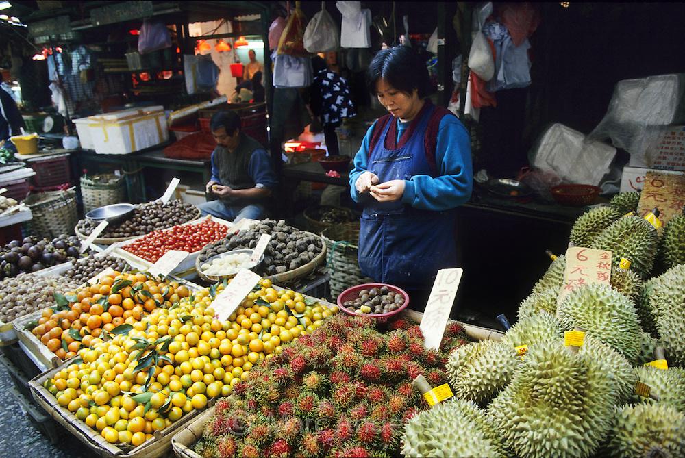 A Market stall selling tropical fruit including Durian & Rambutan, Hong Kong, China.