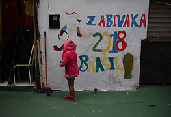 June 16, 2018 - Rio De Janeiro, RIO DE JANEIRO, BRAZIL - Residents of the Favela de Ramos, gathered to adorn the streets of Favela to World Cup, children, adults, elderly people all together to paint the houses and streets of Favela. (Credit Image: © Fabio Teixeira via ZUMA Wire)