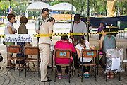 03 MARCH 2013 - BANGKOK, THAILAND: <br /> People get their ballots at a polling place in Benchasiri Park in Bangkok. Bangkok residents went to the polls Sunday to elect a new governor. Voter turnout was expected to be heavy for a local election. Pongsapat Pongchareon, the Pheu Thai candidate is thought to hold a slight lead over Sukhumbhand Paribatra, the Democrats' candidate. There are a total of 25 candidates in the election but only Pheu Thai and the Democrats are given a chance of winning.     PHOTO BY JACK KURTZ
