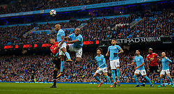 MANCHESTER, ENGLAND - Saturday, April 7, 2018: Manchester United's Chris Smalling challenges Manchester City's Fabian Delph and captain Vincent Kompany during the FA Premier League match between Manchester City FC and Manchester United FC at the City of Manchester Stadium. (Pic by David Rawcliffe/Propaganda)