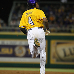 2009 February 20: LSU's Chad Jones watches for the ball as he heads to second base for a double during a NCAA baseball match up between the #1 ranked LSU Tiger and the unranked Villanova Wilcats at the newly constructed Alex Box Stadium in Baton Rouge, Louisiana..