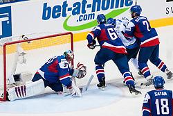 Jaroslav Halak of Slovakia covers a puck during ice-hockey match between Finland and Slovakia of Group E in Qualifying Round of IIHF 2011 World Championship Slovakia, on May 7, 2011 in Orange Arena, Bratislava, Slovakia. (Photo by Matic Klansek Velej / Sportida)
