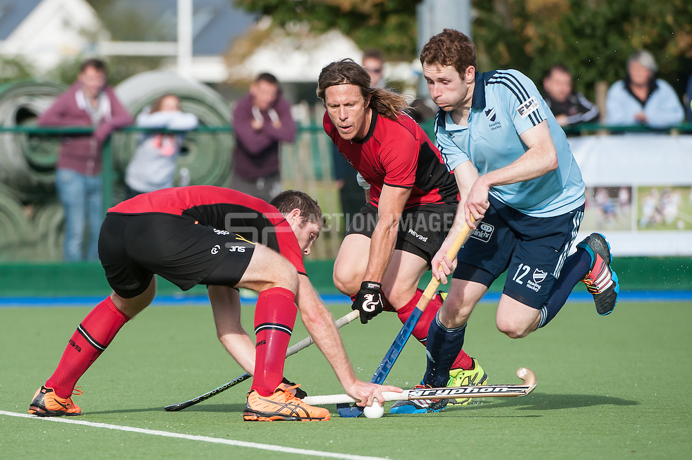Reading's Jonty Clarke is double teamed by Rick Gay and Jonty Robinson of Southgate. Reading v Southgate - Now: Pensions National League Premier Division, Sonning Lane, Reading, UK on 05 October 2014. Photo: Simon Parker