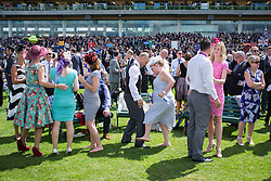 © Licensed to London News Pictures. 18/06/2014. Ascot, UK. People dance during the racing.  Day two at Royal Ascot 18th June 2014. Royal Ascot has established itself as a national institution and the centrepiece of the British social calendar as well as being a stage for the best racehorses in the world. Photo credit : Stephen Simpson/LNP