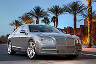 Automotive Photography of 2104 Photo Photo of silver 2104 Bentley Flying Spur W12 shot in front of the Palm Springs Convention center.
