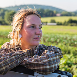 Portrait of a farm worker on a farm on Kinney Hill in South Hampton, New Hampshire.