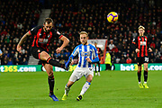 Steve Cook (3) of AFC Bournemouth clears the ball away from Alex Pritchard (21) of Huddersfield Town during the Premier League match between Bournemouth and Huddersfield Town at the Vitality Stadium, Bournemouth, England on 4 December 2018.