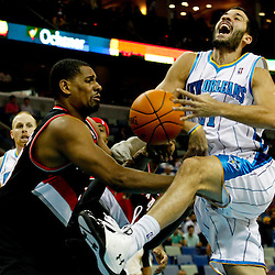 January 16, 2012; New Orleans, LA, USA; New Orleans Hornets point guard Greivis Vasquez (21) is fouled by Portland Trail Blazers center Kurt Thomas (40) during the second quarter of a game at the New Orleans Arena.   Mandatory Credit: Derick E. Hingle-USA TODAY SPORTS