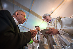 "16 May 2017, Windhoek, Namibia: Outgoing Lutheran World Federation president bishop Munib Younan from the Evangelical Lutheran Church in Jordan and the Holy Land receives Holy Communion. Reaching the end of the Lutheran World Federation's Twelfth Assembly, Church of Sweden Archbishop Rev. Dr Antje Jackelén presided over the Eucharist at closing worship. As the Twelfth Assembly of the Lutheran World Federation is coming to an end, a closing worship service celebrates the LWF Communion and a successful Assembly, and installing the newly elected LWF Council and President. The Twelfth Assembly of the Lutheran World Federation gathers in Windhoek, Namibia, on 10-16 May 2017, under the theme ""Liberated by God's Grace"", bringing together some 800 delegates and participants from 145 member churches in 98 countries."