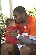 Copyright David Richard<br /> Cleveland Browns quarterback Josh Harris with his two-month-old son, Jacob during the first day of training camp in Berea, Ohio.