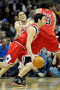 Apr 27, 2010; Cleveland, OH, USA; Chicago Bulls guard Kirk Hinrich (12) gets a pick from Chicago Bulls center Joakim Noah (13) as he drives around Cleveland Cavaliers guard Anthony Parker (18) during the first period in game five in the first round of the 2010 NBA playoffs at Quicken Loans Arena.  Mandatory Credit: Jason Miller-US PRESSWIRE