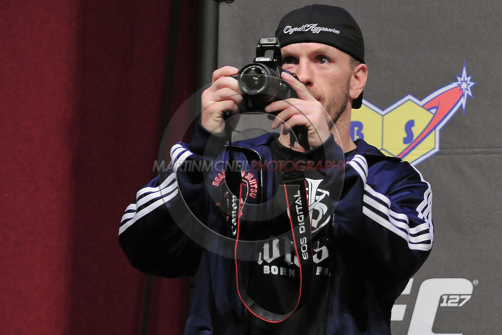 """SYDNEY, AUSTRALIA, FEBRUARY 26, 2011: Spencer Fisher takes a photograph of the crowd during the weigh-in for """"UFC 127: Penn vs. Fitch"""" inside Acer Arena in Sydney, Australia on February 26, 2011"""