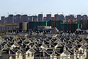 Rows of villas, apartments and construction in the new city of Kangbashi.