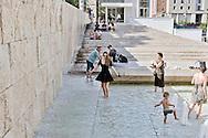 Roma 15 Luglio 2015<br /> Turisti si bagnano nella Fontana di via Ripetta di fronte all' Ara Pacis per alleviare il caldo afoso e la temperatura elevata che secondo la Protezione Civile potrebbe arrivare nel fine settimana  a 40 gradi.<br /> Roma15 July 2015<br /> Tourists try to cool off at the Fountain in via Ripetta in downtown Rome, on a hot mid-summer afternoon. Italy's civil protection department  said a severe heat-wave may hit nine Italian cities. The temperatures may reach and go beyond 40 degrees centigrade.
