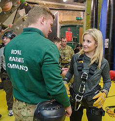 Royal Marines abseil down BT Tower. the BT Tower, London, United Kingdom. Embargoed until Monday, 17th February 2014. Picture by Anthony Upton / i-Images<br /> HISTORIC MOMENT FOR BT TOWER AS CHARITY ABSEIL GETS THE GREEN LIGHT<br /> Marine Sam Magowan with TV presenter Helen Skelton during the training at the Castle Climbing centre, in north London ahead of the first ever charity abseil down BT Tower will take place on 10 March to raise money for Sport Relief and the Royal Marines Charitable Trust Fund using BT's MyDonate online fundraising site.<br /> <br /> The event will also kick off a year of celebrations for the 350th anniversary of the Royal Marines, during which the Royal Marines Charity Trust Fund (RMCTF) aim to raise £6million<br /> <br /> The BT Group Newsroom on its 24-hour number: 020 7356 5369. From outside the UK dial + 44 20 7356 5369. E-mail: newsroom@bt.com<br /> <br /> For photographic enquiries please call Anthony Upton 07973 830 517 or email info@anthonyupton.com <br /> This image is copyright Anthony Upton 2012©.<br /> This image has been supplied by Anthony Upton and must be credited Anthony Upton. The author is asserting his full Moral rights in relation to the publication of this image. All rights reserved. Rights for onward transmission of any image or file is not granted or implied. Changing or deleting Copyright information is illegal as specified in the Copyright, Design and Patents Act 1988. If you are in any way unsure of your right to publish this image please contact Anthony Upton on +44(0)7973 830 517 or email: