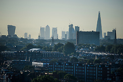 © Licensed to London News Pictures. 14/06/2017. London, UK. A view over the rooftops of Notting Hill in west London showing the London city skyline in the distance, including The Shard, Canary Wharf and the 20 Fenchurch Street skyscraper, AKA the Walkie Talkie Building. Photo credit: Ben Cawthra/LNP