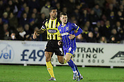 Jake Reeves of AFC Wimbledon, Joss Labadie of Dagenham & Redbridge, during the Sky Bet League 2 match between AFC Wimbledon and Dagenham and Redbridge at the Cherry Red Records Stadium, Kingston, England on 24 November 2015. Photo by Stuart Butcher.
