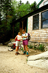 New Hampshire: Hikers on Appalachian Trail to Zealand Hut,  Model Released.  Photo #: nhappa102..Photo copyright Lee Foster, www.fostertravel.com, 510/549-2202, lee@fostertravel.com