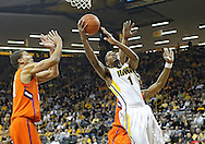 November 29, 2011: Iowa Hawkeyes forward Melsahn Basabe (1) puts up a shot as Clemson Tigers forward Milton Jennings (24) defends during the first half of the NCAA basketball game between the Clemson Tigers and the Iowa Hawkeyes at Carver-Hawkeye Arena in Iowa City, Iowa on Tuesday, November 29, 2011. Clemson defeated Iowa 71-55 in the Big Ten-ACC Challenge game.