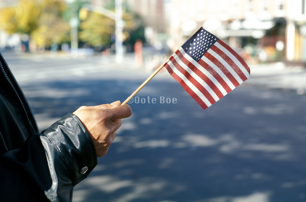 hand waving American flag