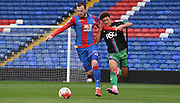 Jordan Mutch holds off the challenge during the Final Third Development League match between U21 Crystal Palace and U21 Bristol City at Selhurst Park, London, England on 3 November 2015. Photo by Michael Hulf.
