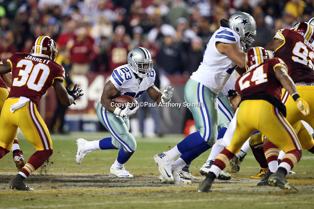Dallas Cowboys running back Robert Turbin (23) follows a blocker as he runs the ball during the 2015 week 13 regular season NFL football game against the Washington Redskins on Monday, Dec. 7, 2015 in Landover, Md. The Cowboys won the game 19-16. (©Paul Anthony Spinelli)