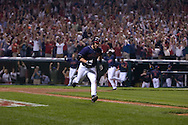 David Richard/MLB.com.Cleveland's Travis Hafner hits a game-winning single in the bottom of the 11th inning of Game 2 as teammate Kenny Lofton, background, scores in the 2007 ALDS at Jacobs Field in Cleveland.