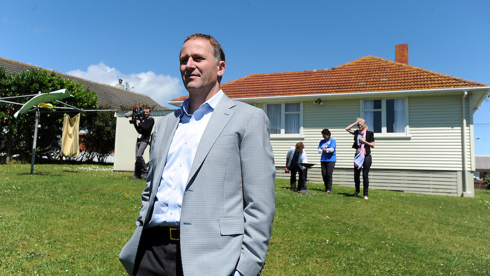 Prime Minister John Key visits a Porirua state house to launch his party's election policy for the continued refurbishment of state housing, Wellington, New Zealand, Saturday, November 05, 2011. Credit:SNPA / Ross Setford