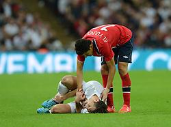 Norway's Tarik Elyounoussi checks if England's Leighton Baines (Everton) is okay after fouling him. - Photo mandatory by-line: Alex James/JMP - Mobile: 07966 386802 - 3/09/14 - SPORT - FOOTBALL - London - Wembley Stadium - England v Norway - International Friendly