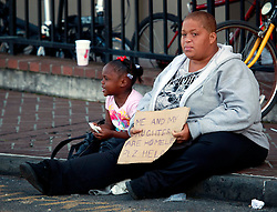 14 Apr 2013. New Orleans, Louisiana,  USA. .A homeless woman and her daughter beg for money in the French Quarter. .Photo; Charlie Varley.