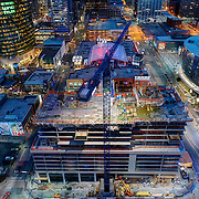 Kansas City, Missouri -downtown area in evening with Two Light Tower construction underway with crane