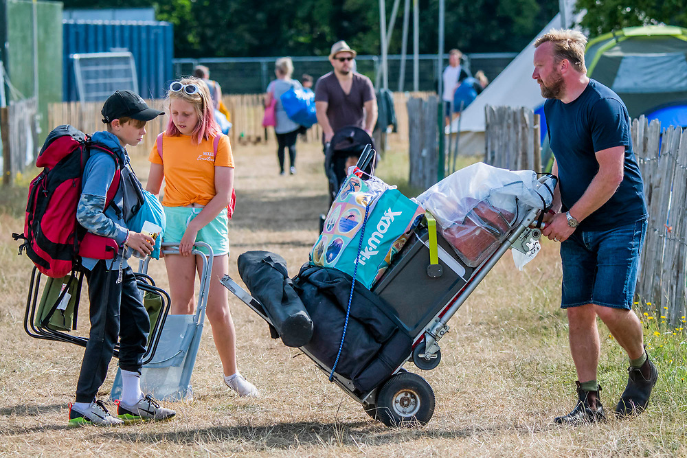 Henham Park, Suffolk, 20 July 2019. The morning of the last day sees people packing for a quick getway later. The 2019 Latitude Festival.