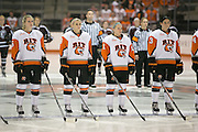 The RIT Women's hockey team lines up for the Canadian and American National Anthems before a game against Union College at the Gene Polisseni Center on October 3, 2014.