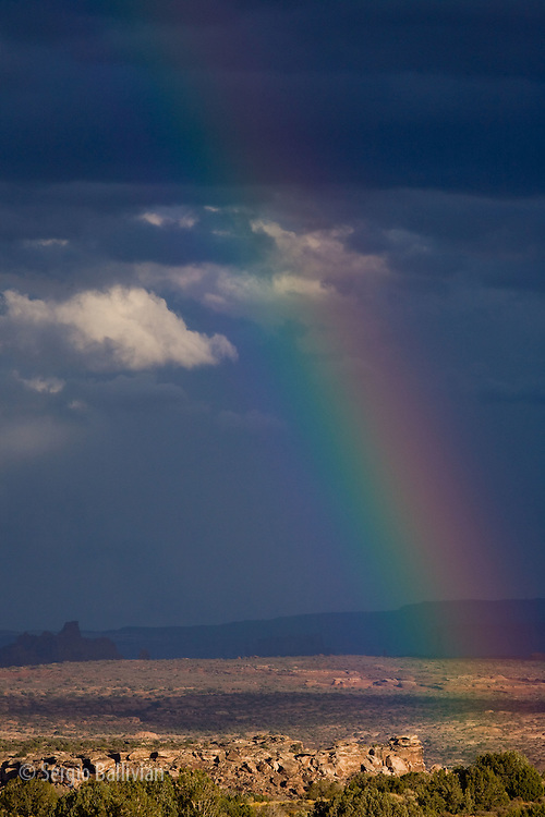 A colorful rainbow after a storm from Willow Flats Road in Arches National Park near Moab, Utah.